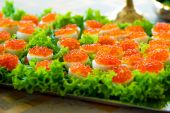 Snacks with red caviar on a festive table